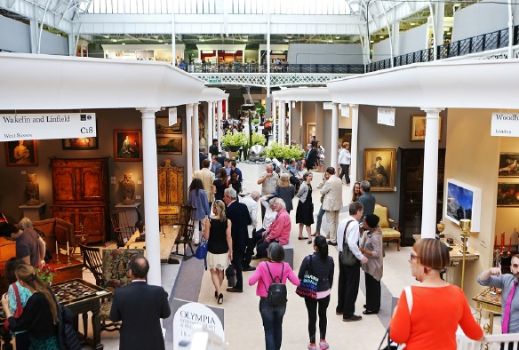 Visitors to Olympia Art & Antiques Fair