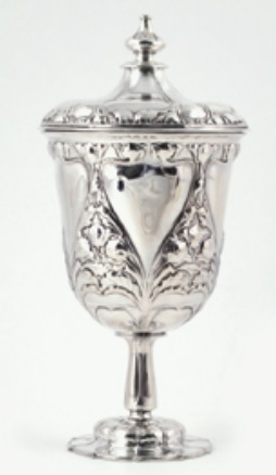 A Liberty and Co silver presentation vase and cover by Katherine Coggin, dated Birmingham 1899