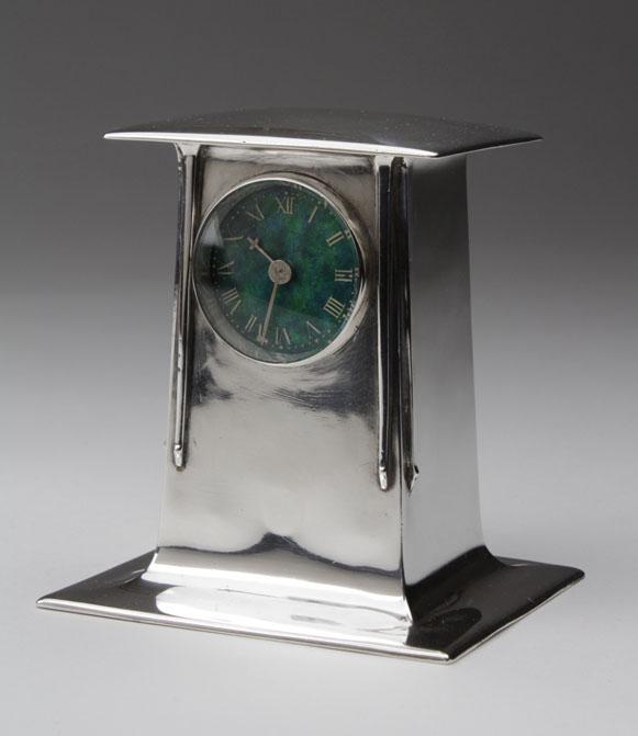 A Liberty & Co Cymric clock designed by Archibald Knox