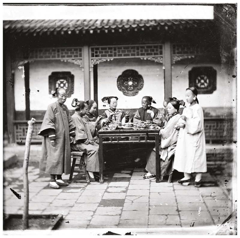 Scottish photographer John Thomson's image of Manchu ladies at a meal table