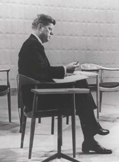 John F Kennedy sitting on Hans J. Wegner's JH501 chair