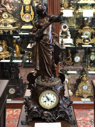 The Lutist antique clock