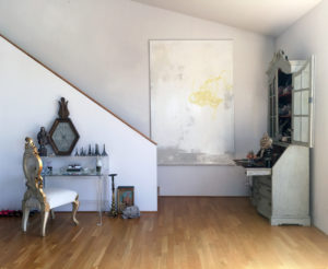 Toma Clark Haines displays original art by Michaela Zimmer in her Diva Headquarters home