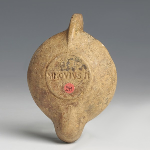 A Roman Terracotta Oil Lamp with Rosette