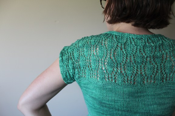 Detail of a Waterlily Tee in turquoise