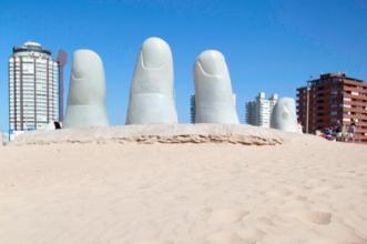 Bizarre? The folks at Azamara Club Cruises (@AzamaraVoyages) have it all wrapped up! It's The Hand landmark in Uruguay: https://twitter.com/AzamaraVoyages/status/481162126967709697/photo/1