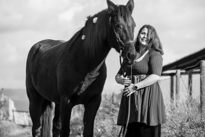 Woman with Black Mare in Countryside