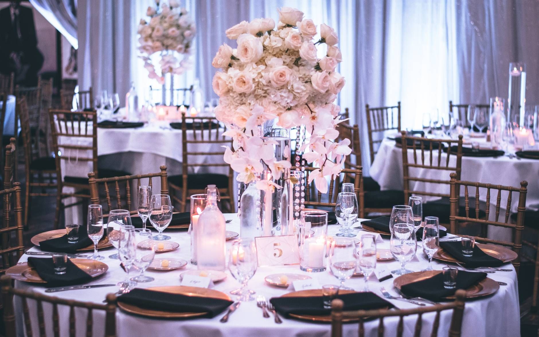 pink and white roses centerpiece on top of table
