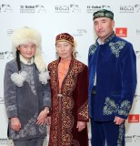 """DUBAI, UNITED ARAB EMIRATES - DECEMBER 10: Aisholpan Nurgaiv, Almagul Kuksygyen and Nurgaiv Rys attend """"The Eagle Huntress"""" red carpet during day four of the 13th annual Dubai International Film Festival held at the Madinat Jumeriah Complex on December 10, 2016 in Dubai, United Arab Emirates. (Photo by Neilson Barnard/Getty Images for DIFF)"""