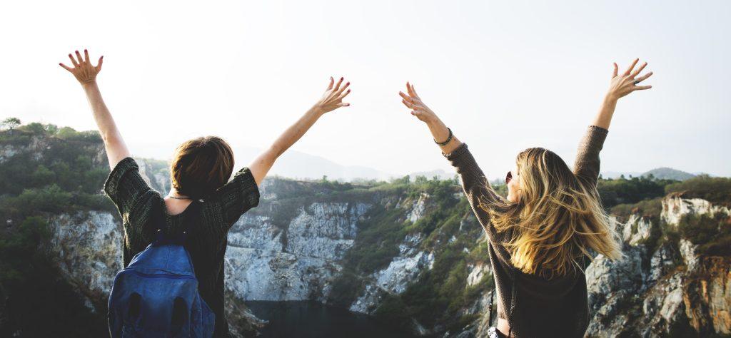 people waving arms in air