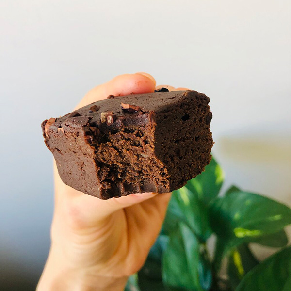 one piece of chocolate brownie with a bite in it