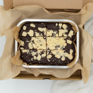 white chocolate topped chocolate brownies in a box