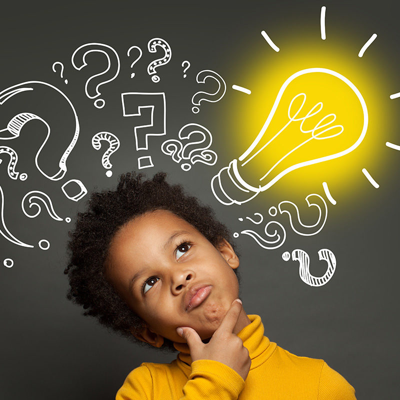 Thinking-child-boy-on-black-background-with-light-bulb-and-question-marks.-Brainstorming-and-idea-concept-web.jpg