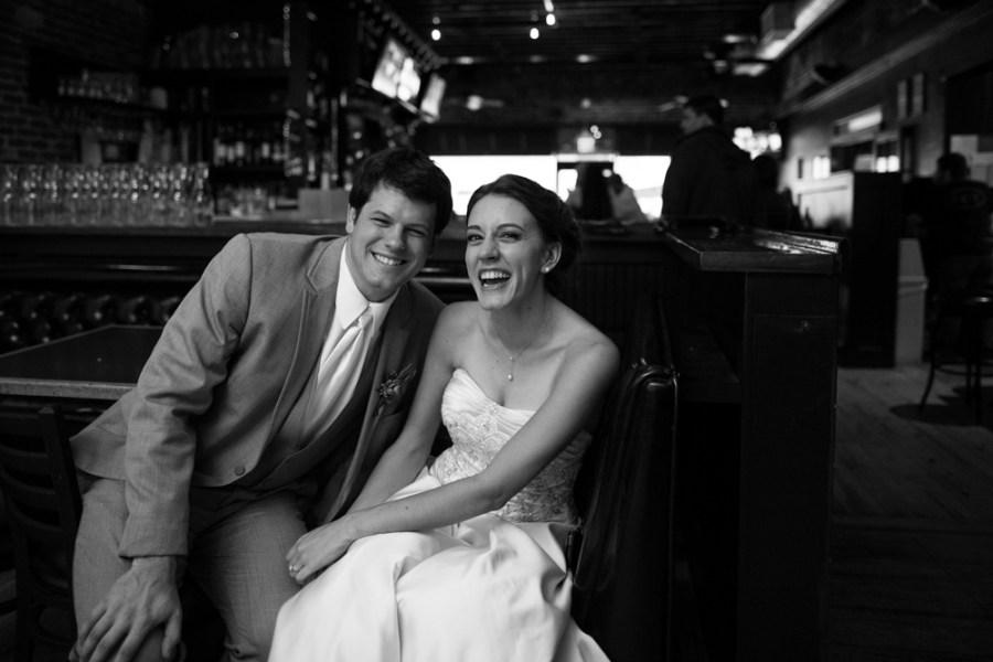 Anya Semenoff and Dan Petty sit at Cap City Tavern during their wedding