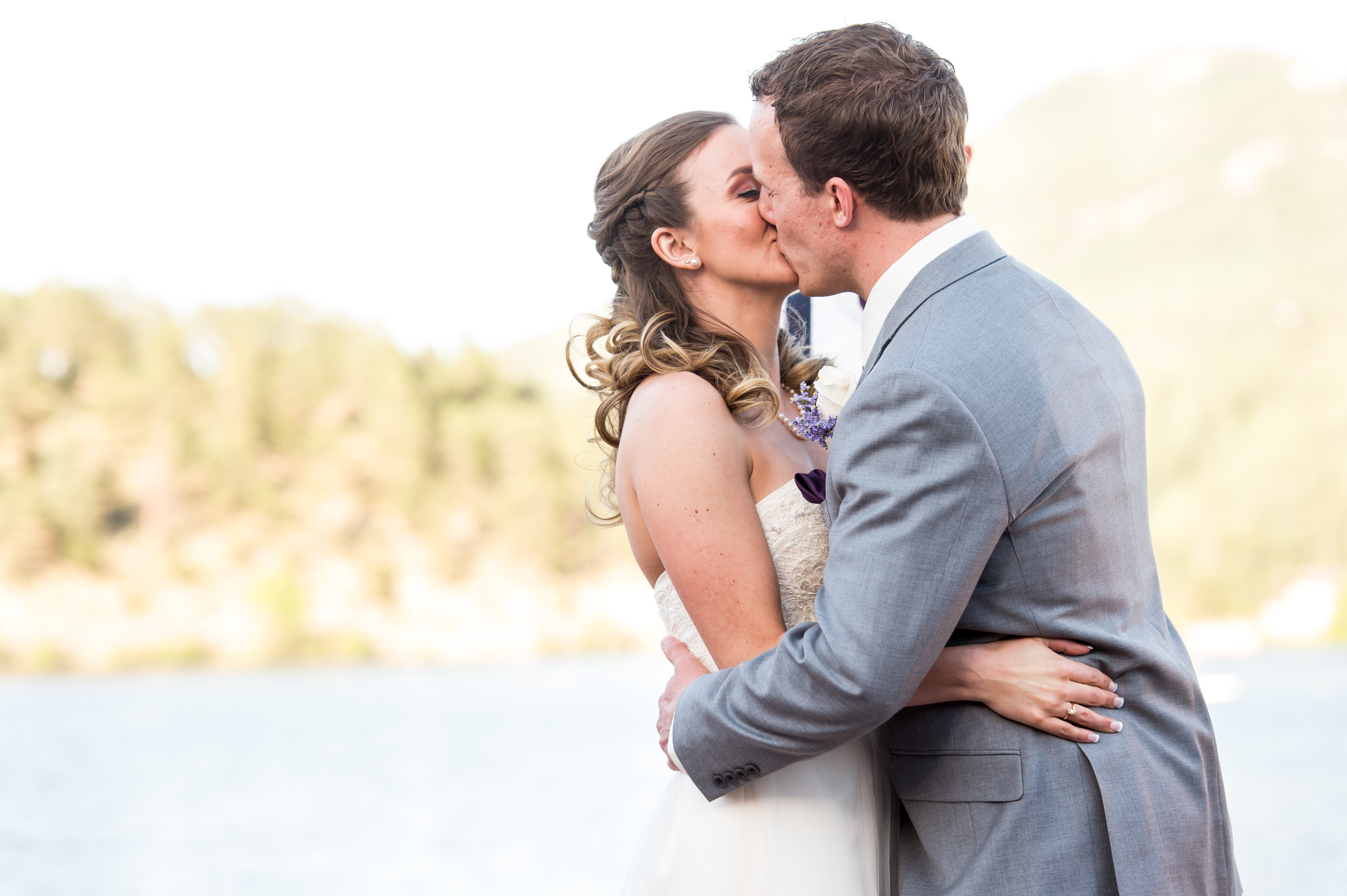 Evergreen Lake House wedding pictures of bride and groom walking sharing their first kiss