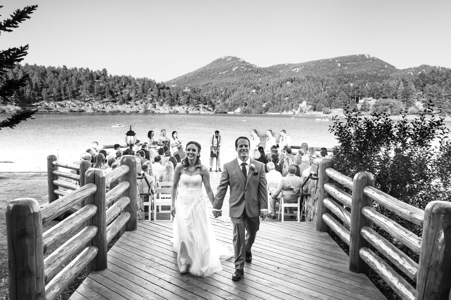 Evergreen Lake House wedding pictures of bride and groom walking down the aisle after their wedding