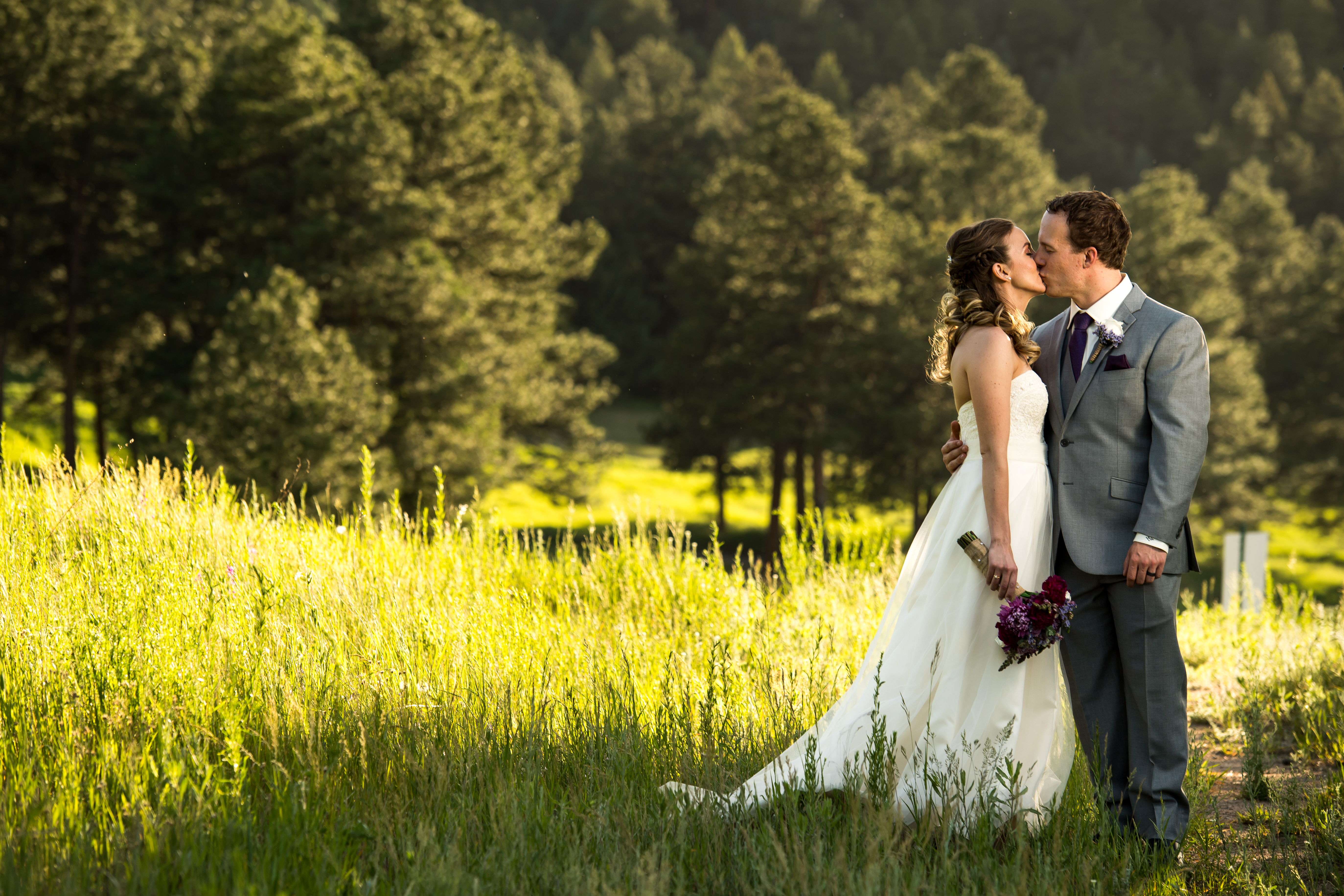 Evergreen Lake House wedding pictures of bride and groom kissing