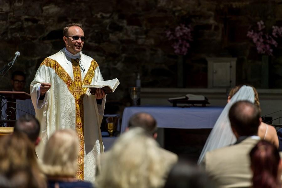 Fr. Brian Larkin preaches during an Our Lady of Lourdes Denver wedding.
