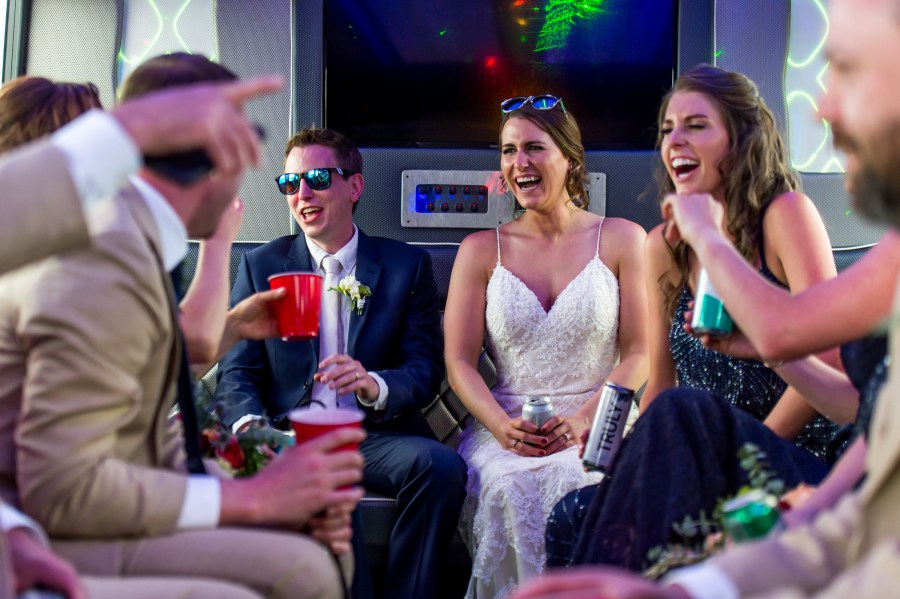 Inside the party bus during an Our Lady of Lourdes Denver wedding.