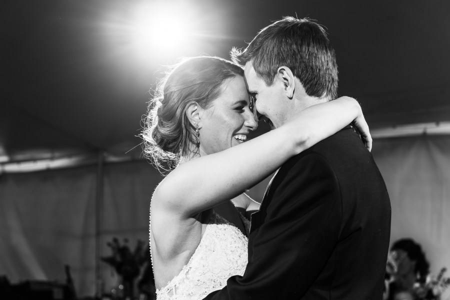Bride and groom first dance during backyard wedding in Colorado