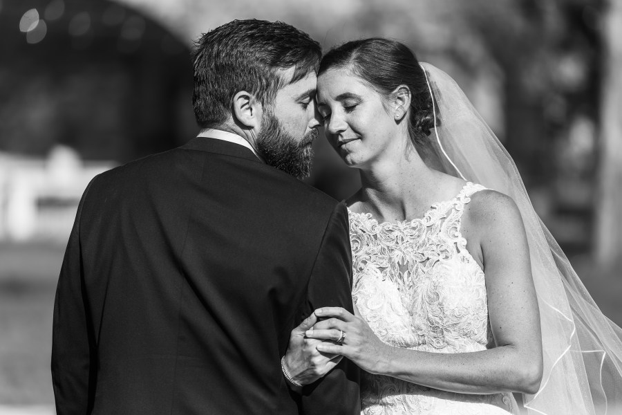 Couple poses after their wedding at Our Lady of Lourdes Catholic Church in Denver, Colorado.