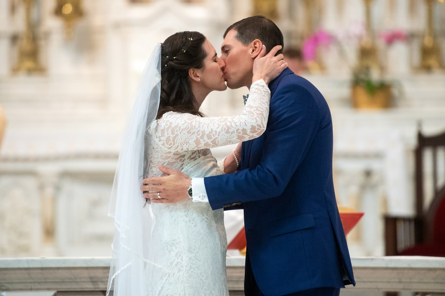 Bride and groom kiss during their Cathedral Basilica of the Immaculate Conception wedding in Denver, Colorado.