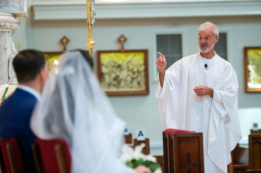 Fr. John Riley preaches during a wedding at the Cathedral Basilica of the Immaculate Conception in Denver, Colorado.