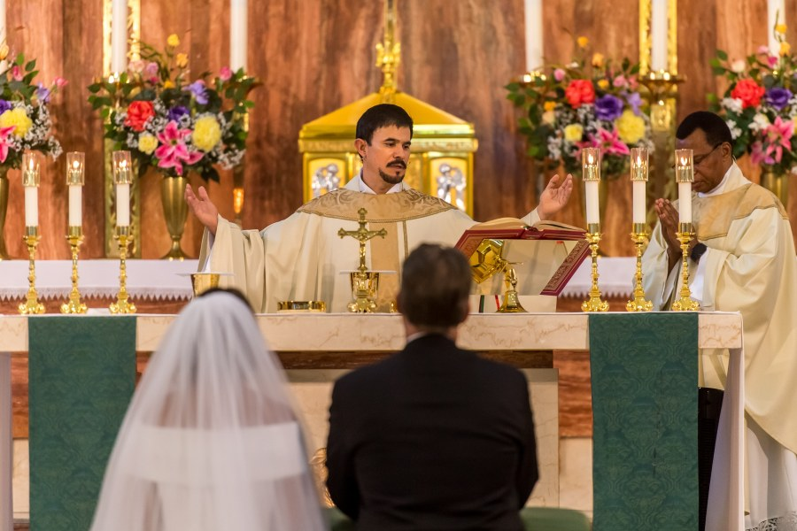 The priest celebrates communion during a wedding Mass at St. Joseph Catholic Church in Fort Collins, Colorado, on August 8, 2020.