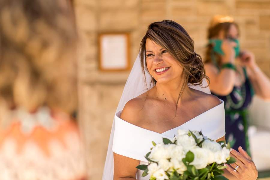 The bride smiles after her St. Joseph Fort Collins Catholic Church wedding on Aug. 8, 2020, in Colorado.