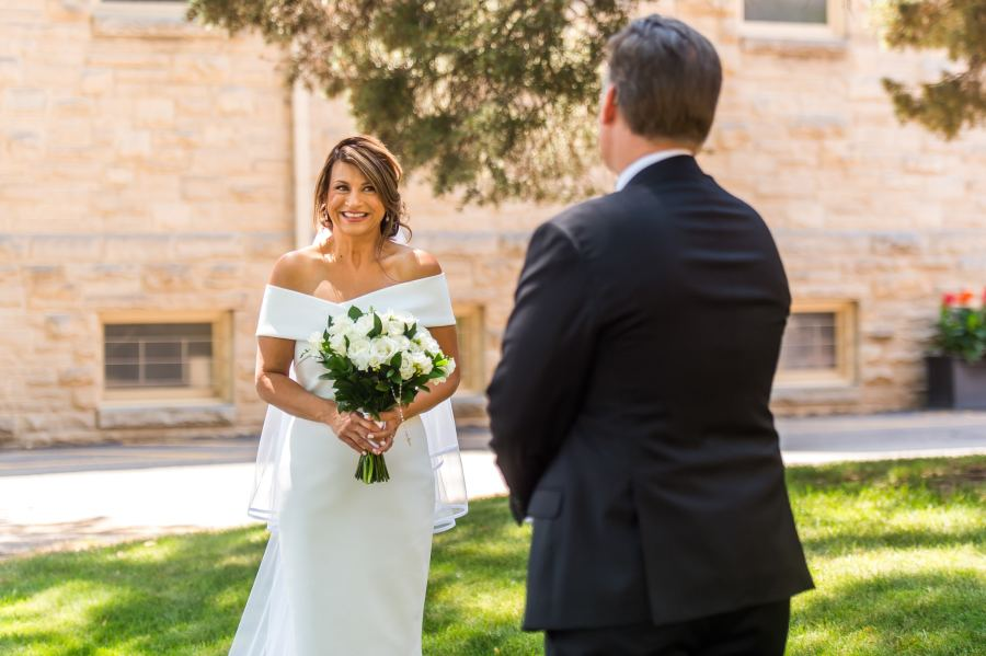 The bride and groom share a first look before their wedding Mass at St. Joseph Catholic Church in Fort Collins, Colorado, on August 8, 2020.