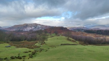 Looking North from High Oxen Fell Farm towards Elterwater, where we were headed later. Big, dark rain clouds in the sky