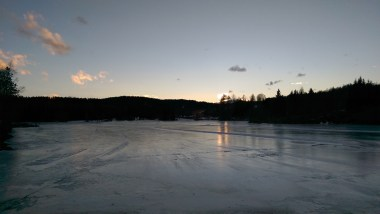 And in the other direction the sun setting over the horizon, reflecting on the frozen lake