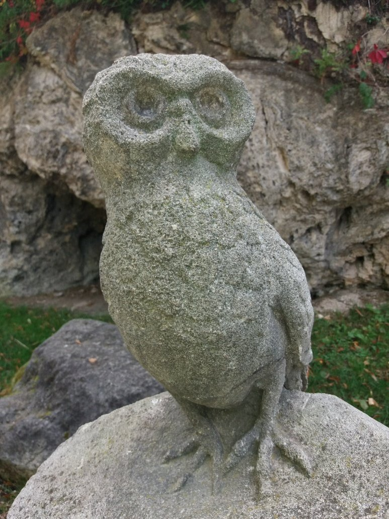 Stone owl in the gardens of Hotel Palota Lillafüred