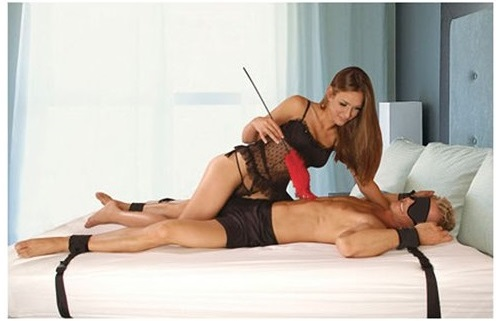 women and man using the ultimate under bed restraints
