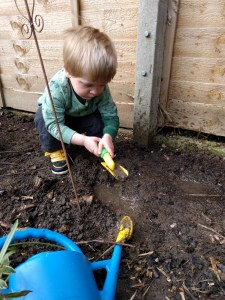 It may look like I'm helping with the gardening, in actual fact I'm digging up the seeds we planted the day before