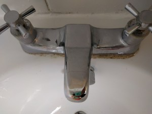 Bath taps, one side treated the other side not