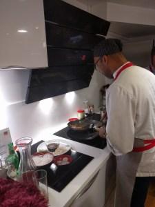 Paddy teaching us some wok skills