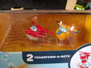Two small super wings toys in packaging