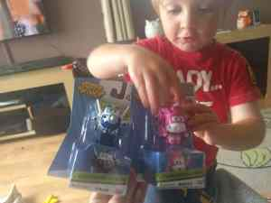 Small boys with two new toys in packaging