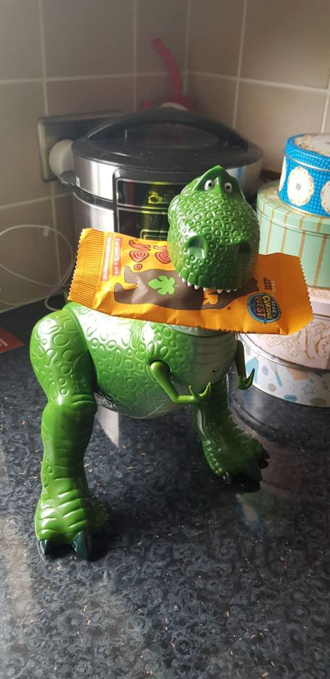 Rex Toy eating a snack