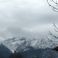 The distant Tatras Mountains spotted from Zakopane City Centre, when the cloud clears a cross can be seen on top.