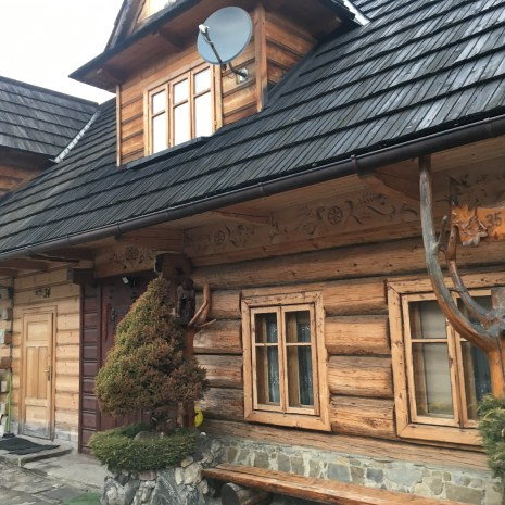 A house in a small village just outside of Zakopane; traditional houses made of wood due to the large amount of surrounding forestry