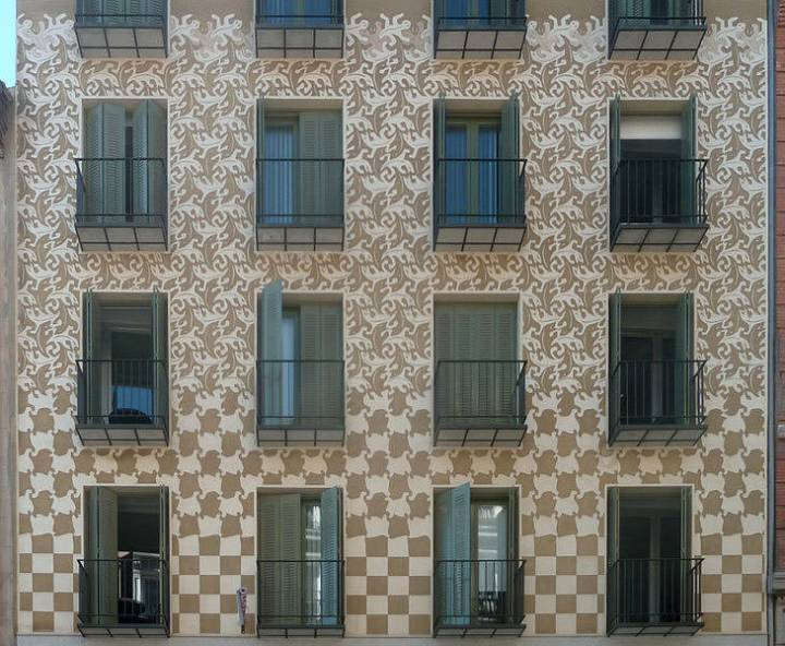Facade decorated showing an Escher's design from Metamorphosis II.