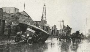 muddy streets and oil derricks