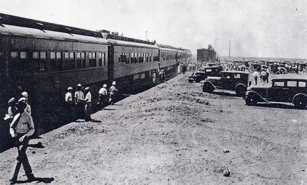 The Texas–New Mexico Railway - incorporated after oil discoveries in the Permian Basin - was completed in 1930 as a shortline railroad operating in west Texas and southeast New Mexico. Hobbs residents flocked to the train when it arrived on April 19, 1930. Photo courtesy HobbsHistory.com