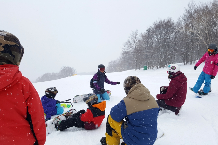 coaching skiers and snowboarders at freestyle camp