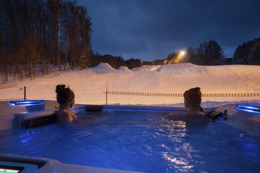 Maddie Bowman and Brita Sigourney in the Aspen House Jacuzzi
