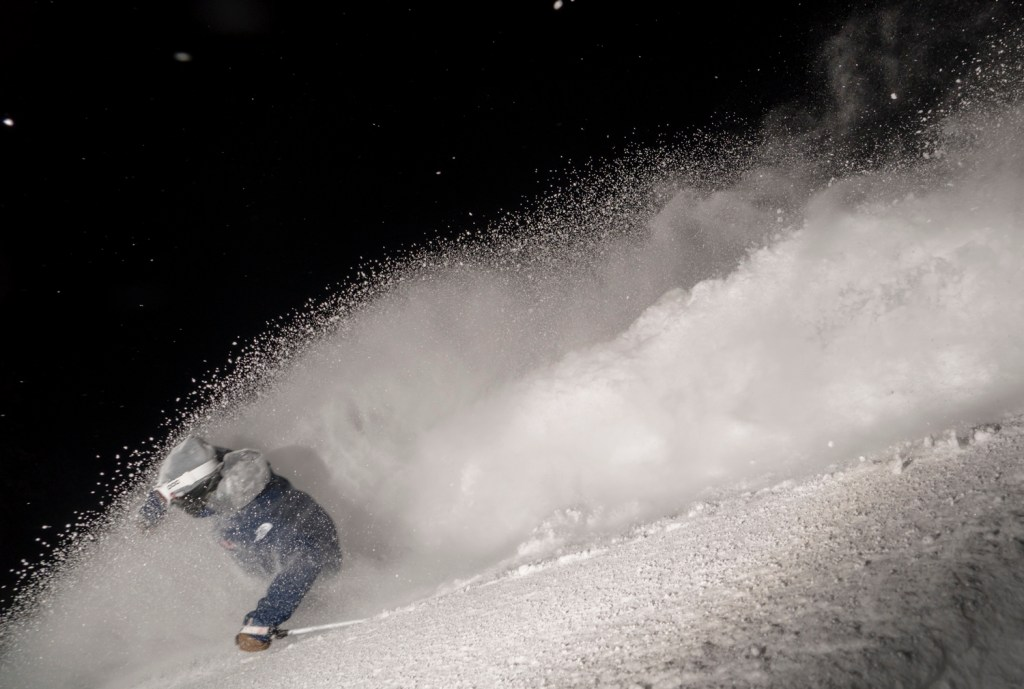 Aaron Blunck night skiing in the powder