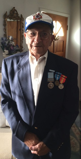 Photo of Mr. John Joseph Scala proudly displaying his service medals