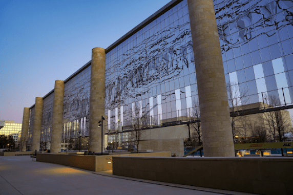 Photograph showing the Eisenhower Memorial in Washington, DC. Light reflects off the building.